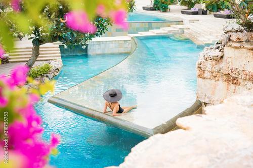 Woman in exotic swimming pool