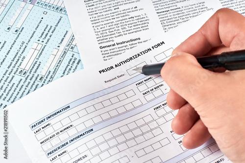 Canvas Print Human fills a prior authorization form