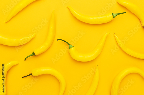 hot chilli peppers on the yellow background