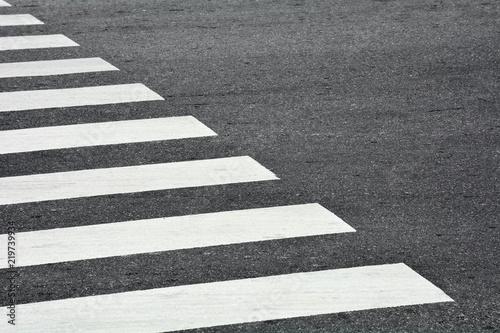 Fotografija Zebra crosswalk on a asphalt road - closeup background
