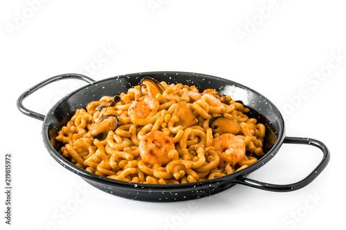 Traditional Spanish fideua. Noodle paella isolated on white background.