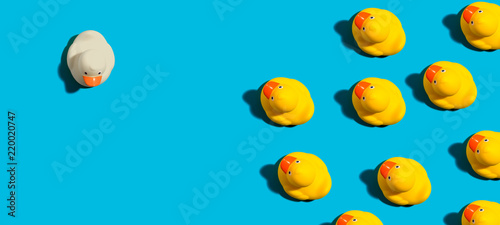 Fotografia One out unique rubber duck concept on a blue background