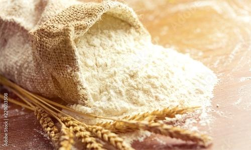 Canvastavla Wheat ears and flour on  background