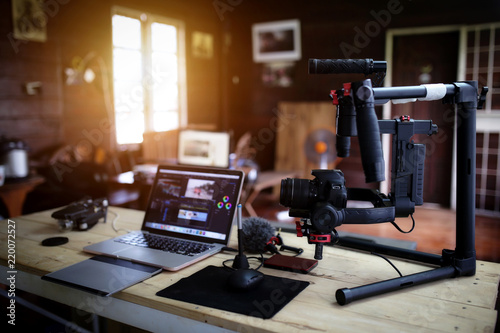 Vlogger equipment for Filming a movie or a video blog Drone Steadicam Camera Stabilizer and laptop.