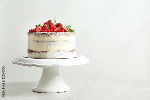 Delicious homemade cake with fresh berries and space for text on light background