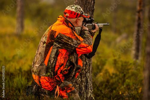 Hunter in the wilderness seeking prey