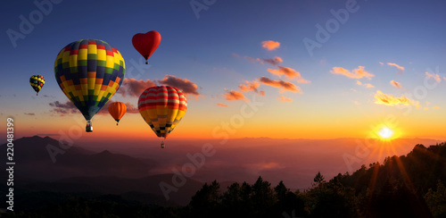 Leinwand Poster Hot air balloons with landscape mountain.