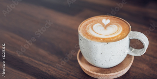 Canvas-taulu hot cappuccino coffee cup on wooden tray with latte art on wood table at cafe