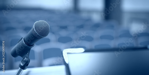 Photo Rostrum with microphone and computer in conference room