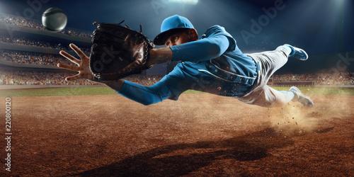 Canvas Print Baseball shortstop catches the ball on professional baseball stadium
