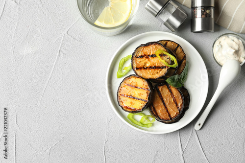 Plate with fried eggplant slices on table, top view. Space for text