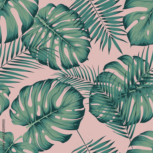 Fotografiet Seamless tropical pattern with leaves monstera and areca palm leaf on a pink bac