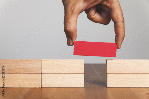 Canvas Man solving problems by building bridge with red wooden block