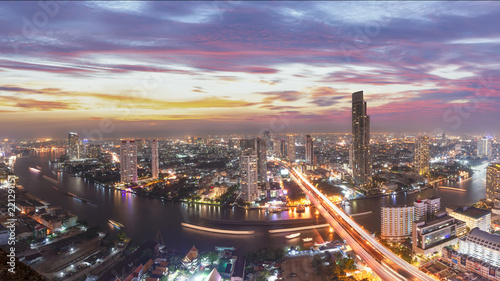 Bangkok capital city of thailand.Scenic landscape of Bangkok skyline with dramatic sky before sunset with modern skyscraper and Chao Phraya river in background.