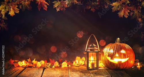 Canvastavla Halloween pumpkin with lantern on wooden