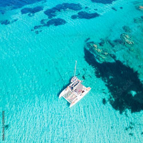 Drone aerial view of catamaran sailing boat in Maddalena Archipelago, Sardinia, Italy Fototapet