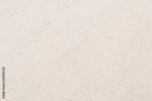Particleboard, chipboard background with grainy texture of particle presses wooden panel or OSB Oriented strand board in light brown cream sepia color