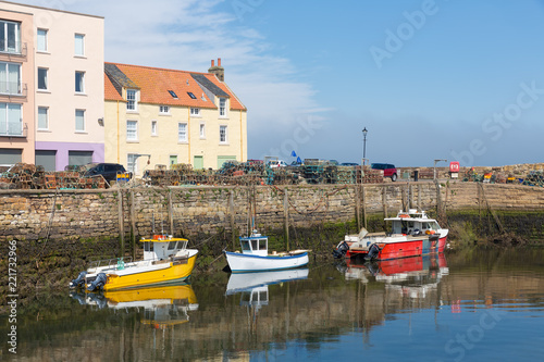 Small fishing ships and lobster fykes in harbor St Andrews, Scotland