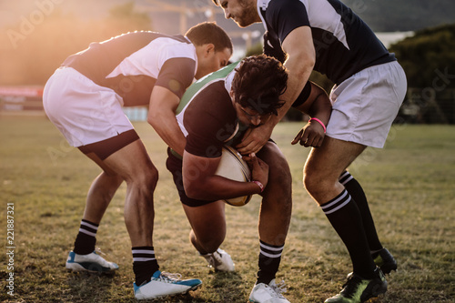 Rugby players striving to get to the ball