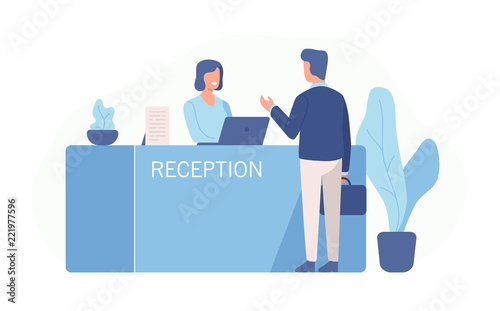 Male customer standing at reception desk and talking to female receptionist Fototapeta