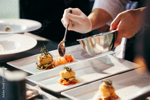 Fotografiet Chef preparing food, meal, in the kitchen, chef cooking, Chef decorating dish, c