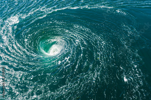 Photo A powerful whirlpool is generated at the surface of the green waters of the river Rance by the action of a turbine of the tidal power station near Saint-Malo in Brittany, France