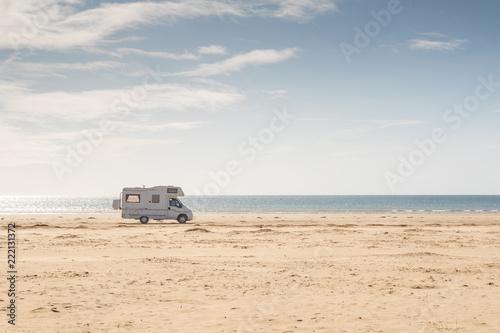 Canvas Print Campervan parked on the beach