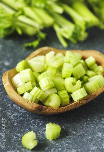 Fresh celery in wooden bowl