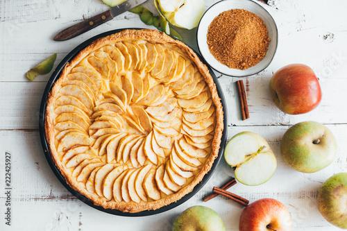 Homemade apple pie tart on white wooden background