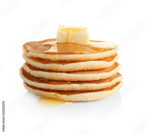 Stack of pancakes with butter and honey on white background