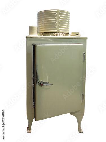 Old refrigerator vintage fridge with chrome handle isolated on white background