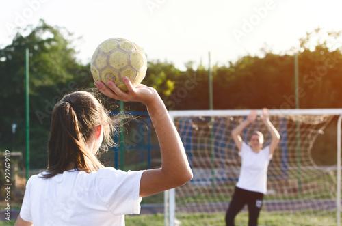 Handball player trowing a ball