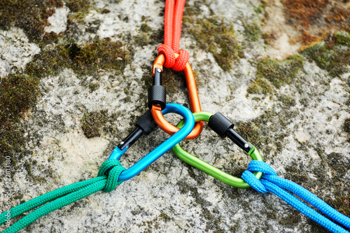 Carabiner  on rocky background.