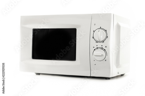 Microwave oven close up isolated on white background. Kitchen equipment. Kitchen and household appliances