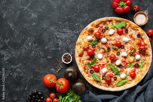 Italian Pizza On Black Concrete Background. Copy Space For Text. Tasty Pizza