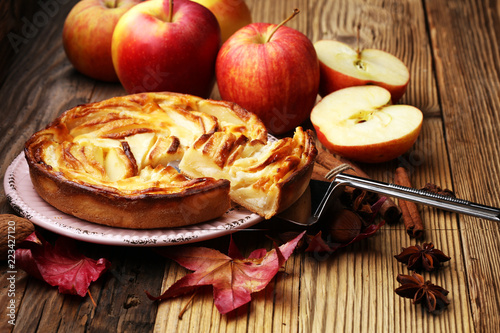 Apple tart. Gourmet traditional holiday apple pie sweet baked dessert food with cinnamon and apples on vintage background. Autumn decor. Rustic style.