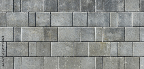Photo Concrete or cobble gray pavement slabs or stones  for floor, wall or path