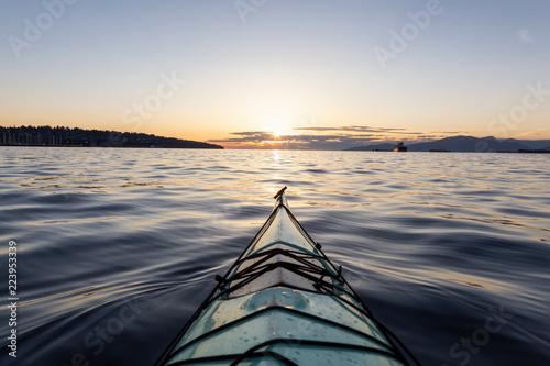 Wallpaper Mural Sea Kayaking during a vibrant sunny summer sunset