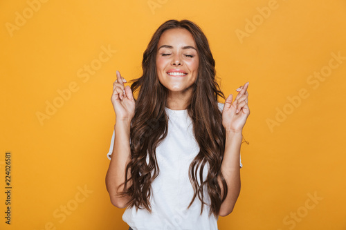 Tablou Canvas Portrait of a happy young girl with long brunette hair