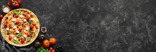 Obraz na plátně Italian pizza and pizza cooking ingredients on black concrete background