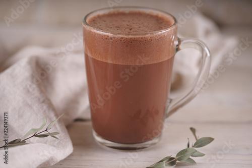Glass mug with cocoa
