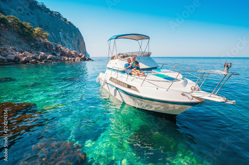Couple on a Boat. Luxury vacation on the Yacht young man and woman. Sailing the Sea.