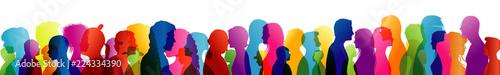 Talking crowd. Dialogue between people. Colored silhouette profiles. People talking. Multiple exposure