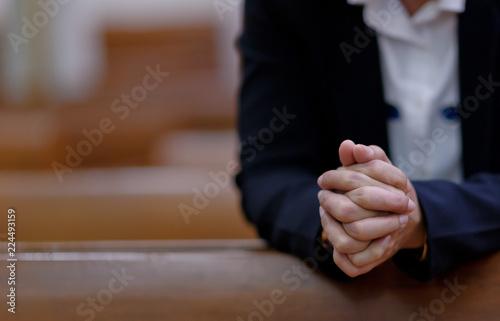 Fotografija woman praying in morning, hands folded in prayer