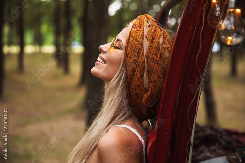 Canvas Print Photo of european hippie woman, wearing stylish accessories looking aside while
