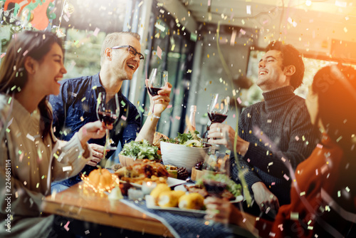 Obraz na płótnie happiness friends christmas eve celebrate dinner party with food wine and laugh