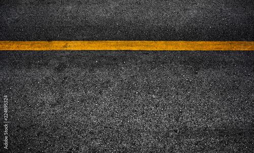 Slika na platnu Yellow paint line on black asphalt