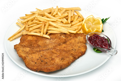 Fototapeta Italian food, Milanese schnitzel with fries  served on white plate, isolated on