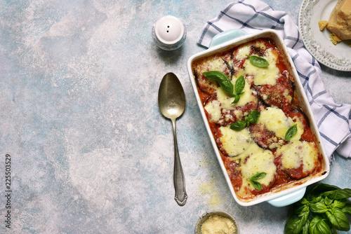 Italian eggplant dish melanzane alla parmigiana.Top view with copy space.