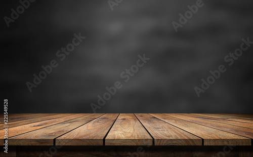 Obraz na płótnie Wooden table with dark blurred background.